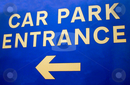 Car Park Entrance Sign stock photo, Close up of blue car park entrance sign with arrow pointing left. by Martin Crowdy