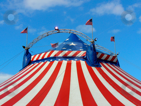 Day out at the circus stock photo, Circus big top tent in field decorated with stars and stripes. by Martin Crowdy