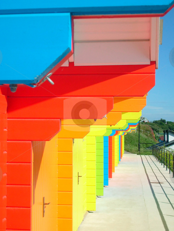 Colorful beach chalets stock photo, Colorful beach chalets seen in a row. by Martin Crowdy