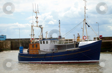 Fishing trawler in harbor stock photo, Fishing boat in Brislington harbour, England. by Martin Crowdy