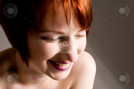 Laughing red stock photo, Short haired red haired beauty having fun by Frenk and Danielle Kaufmann
