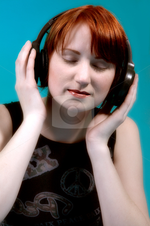 Listening to my music stock photo, Red haired girl listening to her favourite music by Frenk and Danielle Kaufmann