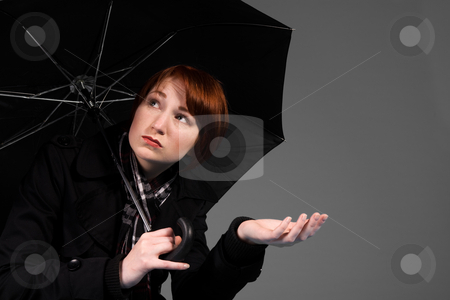 Feeling that its raining stock photo, Young red haired girl with her umbrella by Frenk and Danielle Kaufmann