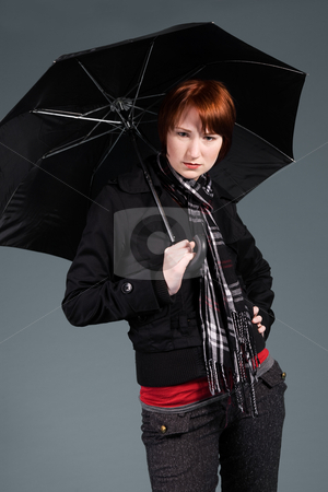 Waiting with my umbrella stock photo, Young red haired girl with her umbrella by Frenk and Danielle Kaufmann
