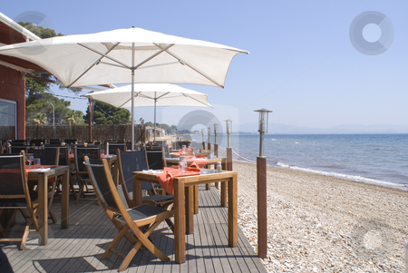 Table for two stock photo, Restaurant on the beach in French Riviera. by Serge VILLA