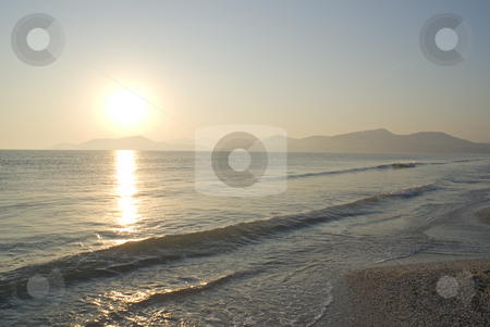 Sunset on beach stock photo, Sunset on beach in French Riviera. by Serge VILLA
