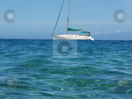 Sailboat from the Ocean stock photo, A sailboat at sea on the ocean by Jeff Clow