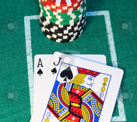 Blackjack close up. stock photo, Blackjack and a stack of chips on a felt background by Steve Stedman