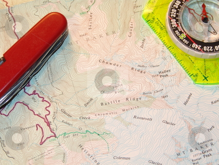 Map And Compass stock photo, Liquid filled compass upon a backpacking paper map. Magnetic compass. by Steve Stedman