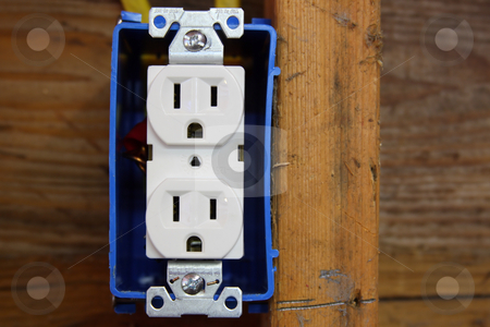 Electrical Outlet stock photo, Electrical outlet in an open wall during construction. by Steve Stedman