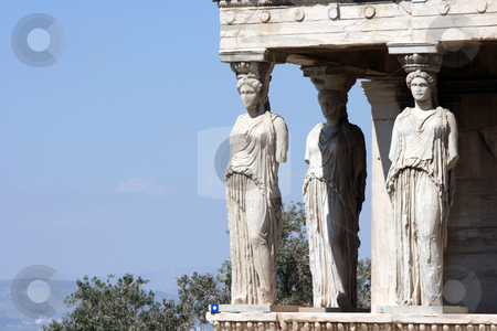 Caryatids copy space stock photo, Caryatids and nature at Erechtheum on Parthenon in Athens, Greece by EVANGELOS THOMAIDIS