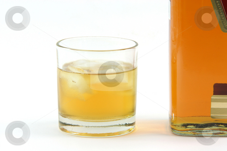 Whiskey glass stock photo, Whiskey glass and bottle detail isolated on white background with copy space by EVANGELOS THOMAIDIS