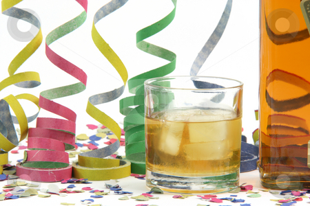 Whiskey party stock photo, Party confetti and botle by EVANGELOS THOMAIDIS