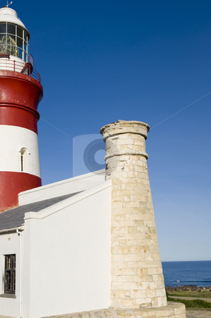 Beautiful historical lighthouse on the Southern-most tip of Afri stock photo, The second oldest and Southern-most lighthouse in Africa at Cape Aghullas, built in 1848. A small piece of the Indian ocean is visible to the right. by Nicolaas Traut
