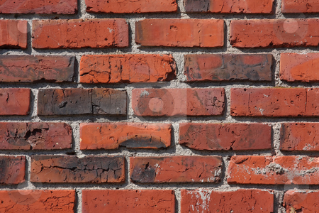 Old Brick and Mortar Wall stock photo, A wall of older red bricks with white mortar, aged over the years. by Steve Stedman