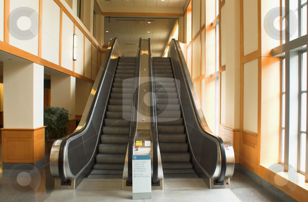 Escalator stock photo, A bank of moving escalators in a building. by Robert Byron