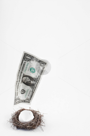 Disappearing Nest Egg stock photo, A dollar bill escaping from a nest egg. by Robert Byron