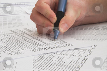 Tax Forms stock photo, A person attempting to do his taxes. by Robert Byron