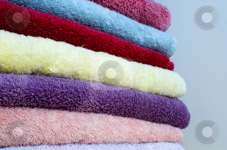 Towels stock photo, A stack of assorted colored trry cloth towels. by Robert Byron