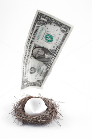 Disappearing Nest Egg stock photo, A dollar bill flying away from a nest egg. by Robert Byron