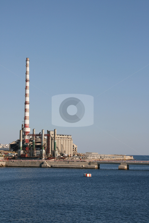 Sea and industry plant stock photo, Big red and white chimney in a factory plant by the sea in piraeus athens greece by EVANGELOS THOMAIDIS