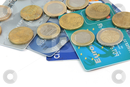 Credit cards stock photo, Credit cards and euro currency coins isolated on white background with copy space by EVANGELOS THOMAIDIS
