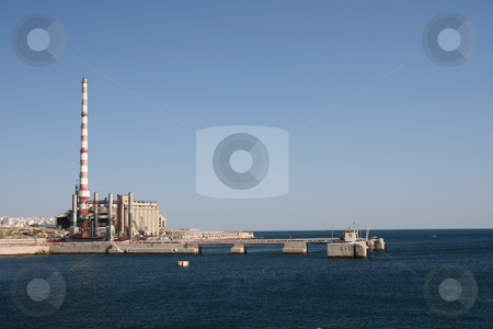 Factory plant by the sea stock photo, A factory plant by the sea at piraeus athens greece horizontal shut by EVANGELOS THOMAIDIS