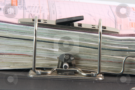 Binder and documents stock photo, Detail from open black business folder with binder full of documents by EVANGELOS THOMAIDIS
