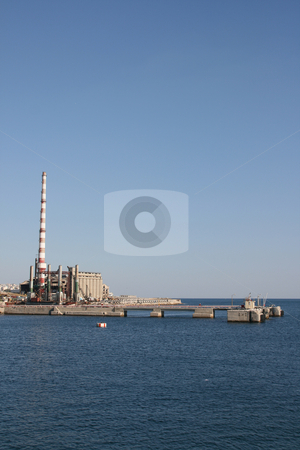 Factory plant vertical stock photo, A factory plant by the sea at piraeus athens greece vertical shut by EVANGELOS THOMAIDIS
