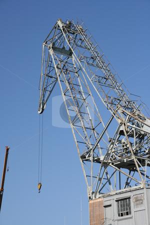 Cargo crane stock photo, Old cargo crane above ship loading at piraeus athens greece by EVANGELOS THOMAIDIS
