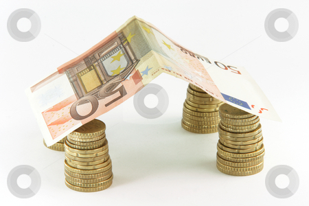 Euro coin house stock photo, Finance banking constuction and business concepts house made with euro coins and fifty euros bill by EVANGELOS THOMAIDIS