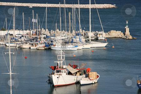 Fishing boats in marina stock photo, Fishing boats and sail yachts in marina at piraeus athens greece horizontal by EVANGELOS THOMAIDIS