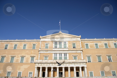 The greek parliament stock photo, View of the greek parliament on a total blue sky with pigeons flying arount by EVANGELOS THOMAIDIS