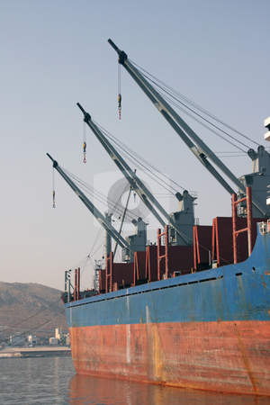 Cargo ship cranes stock photo, Three cargo ship cranes in a row cargo and shipping industry by EVANGELOS THOMAIDIS