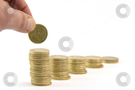 Add a coin stock photo, Adding a coin to stacks of fifty euro cents in a row isolated on white background business and finance concepts by EVANGELOS THOMAIDIS