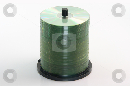 Stack of cds stock photo, Stack of  blanck copact discs isolated on white background by EVANGELOS THOMAIDIS
