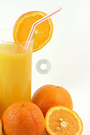 Glass orange juice stock photo, Healthy eating glass of orange juice with straw and slice of orange by EVANGELOS THOMAIDIS