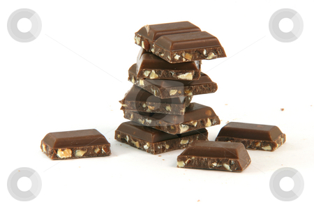 Pieces of chocolate isolated stock photo, Pieces of  chocolate on stack closeup with copy space isolated on white background food and sweets concepts by EVANGELOS THOMAIDIS