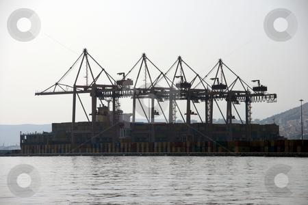 Cargo cranes stock photo, Commercial cargo port cranes at the port of piraeus athens greece by EVANGELOS THOMAIDIS