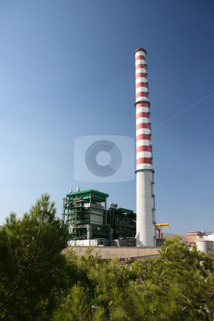 Plant and trees stock photo, Steam electric power plant with high red and white chimney above trees at piraeus athens greece by EVANGELOS THOMAIDIS