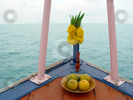 Flowers for buddha stock photo, Flowers and fruits for buddha for good luck thai tradition in fron of all boats in thailand horizontal by EVANGELOS THOMAIDIS