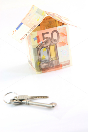 Money house and keys stock photo, Finance banking constuction and business concepts house with euro money and keys blur in front isolated on white background by EVANGELOS THOMAIDIS