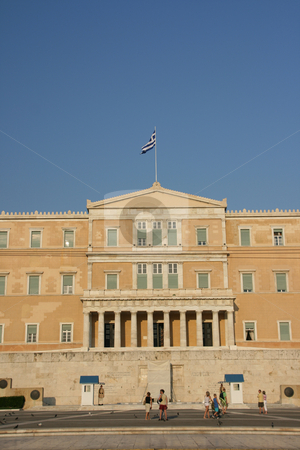 Parliament and tourists stock photo, Greek parliament exterior verical shut with tourists and guards landmakrs of athens greece by EVANGELOS THOMAIDIS