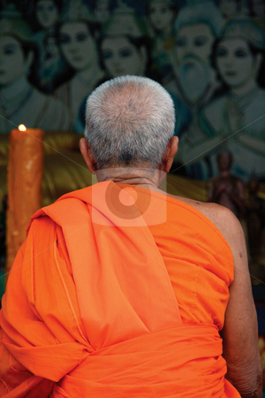 Buddhist monk pray stock photo, Buddhist monk pray to buddha at big buddha temple samui island thailand by EVANGELOS THOMAIDIS