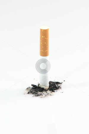 Quit smoking stock photo, Health and addiction concepts cigarette and ashes isolated on white background by EVANGELOS THOMAIDIS