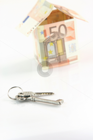 Keys and euros stock photo, Finance banking constuction and business concepts blur house with euro money and focus on keys isolated on white background by EVANGELOS THOMAIDIS