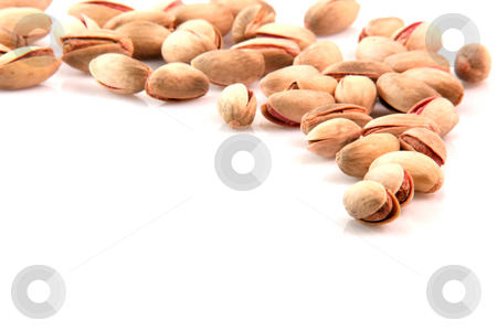 Pistachios border stock photo, Pistachios border with copy space isolated on white background food concepts by EVANGELOS THOMAIDIS