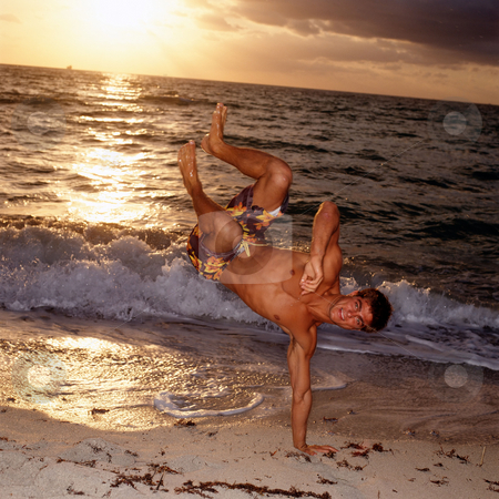 MPIXIS550565 stock photo, Man doing handstands on beach by Mpixis World