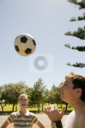 MPIXIS570127 stock photo, Woman watching man heading football by Mpixis World