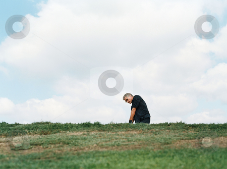 Golfer in a sand trap stock photo, Golfer in a sand trap by Mpixis World